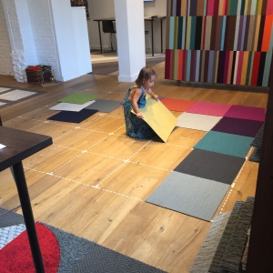 There is no better time-killer than to tell a preschooler with OCD-like tendencies to arrange carpet squares at the FLOR showroom. Millie was in heaven.
